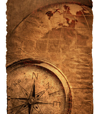 Compass and globe on a richly textured surface